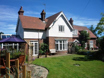 Photo for Delightful ground floor cottage with parking and gardens, excellent location