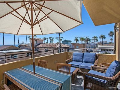 Photo for OCEANSIDE BEACH located by pier and marina! Ocean Views! Walk to Village!
