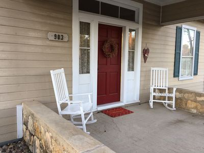 Our front porch is a welcoming area where you can sit back, rock and visit.