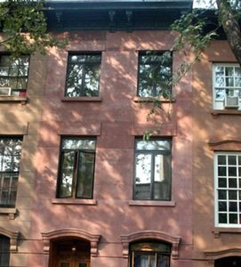 Brownstone Exterior... the apartment is in the front with the arrow