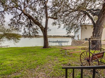 Photo for NEW LISTING! Waterfront home w/shared pool, hot tub & water trampoline - dogs OK