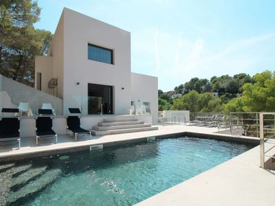 Photo for 7 bedroom Villa, sleeps 14 with Air Con, FREE WiFi and Walk to Beach & Shops