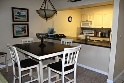 Newly renovated dining area with kitchen in background