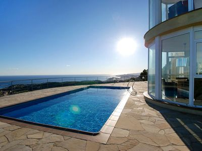 Photo for Located in a quiet street in the urbanization of La Riviera just above Villa Riviera Dos, this luxur