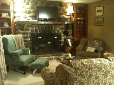 Comfortable great room with large wood burning fireplace.