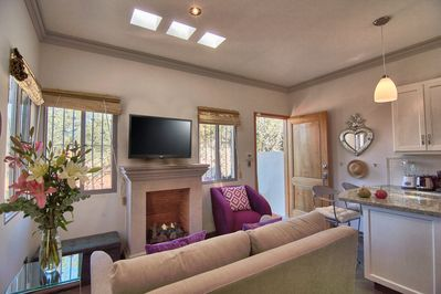 Open living room/kitchen with gas fireplace, smart TV