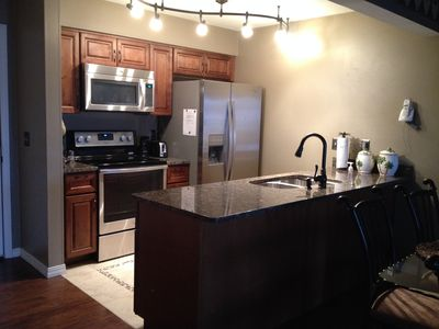 New kitchen with Granite countertops and stainless appliances.