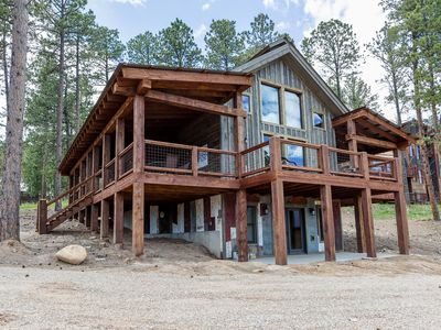 Family fun vacation home with private hot tub and shared swimming pool!
