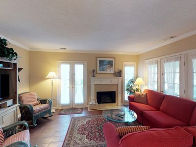 Photo for Golf course view villa w/ patio & shared pool/tennis - walk to the beach!