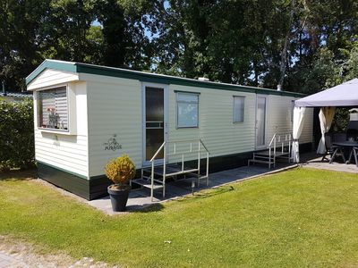 Photo for Chalet on a hospitable family camp site in Burg-Haamstede