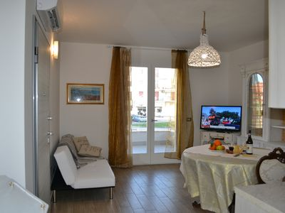 Photo for Elegant and comfortable apartment a few steps from the sea and the historic center.
