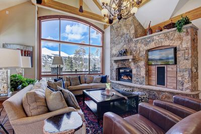 Enjoy the views of the mountains from the large living room windows.