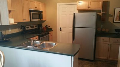 Kitchen with Double Sink, Fridge, Stove, Microwave, Water Cooler, Coffee Pot and General Kitchen/Cooking Supplies. Byo-Food & Beverages
