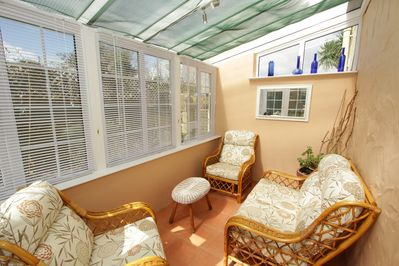 Comfortable Conservatory to relax in.