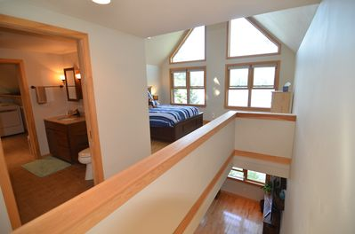 clean, modern, open transition from the living room to the Master bedroom