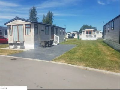 Photo for Flamingo Land Le Maple Grove Caravan
