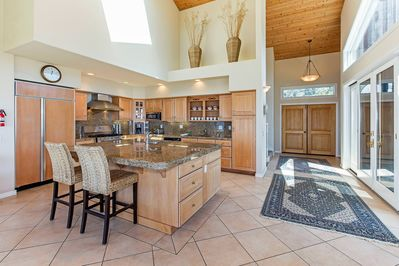 Modern kitchen with granite counters and breakfast bar