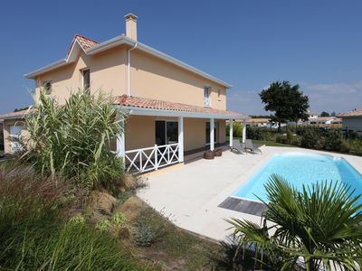 Photo for Beautiful and warm villa in Arès Bassin Arcachon Heated pool, large garden