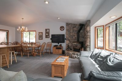 open plan living room with wood stove