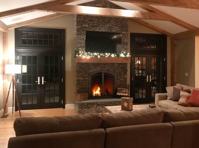 Stacked-stone fireplace and french doors.