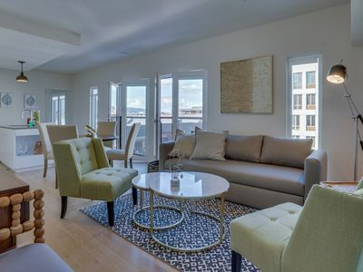 Photo for Sunny condo w/ shared grills - walk to restaurants, shops, parks & more!