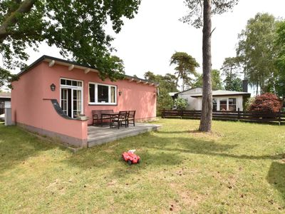 Photo for Bungalow with fireplace, facing right onto a campsite beach