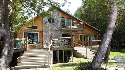 Photo for 10% off Fall Special!!!BEAUTIFUL LAKEFRONT 5 BEDROOM 3 BATH LOG HOM