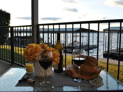 Photo for Lake Front Condo 15 feet from the shore line with Large Outside Patio!