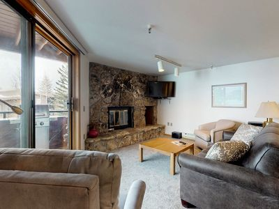 Photo for Lakefront condo w/ mountain views, shared hot tub - walk to town & ski access