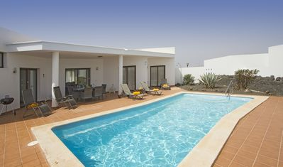 Photo for Spacious 2 bed, 2 bath villa, air con, dishwasher, Free WIFI, 5 mins to supermarket, south facing garden - Villa Sonja