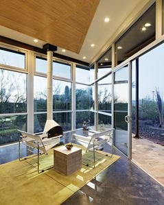 Recessed lighting throughout, sliding doors leading to one of two stone decks