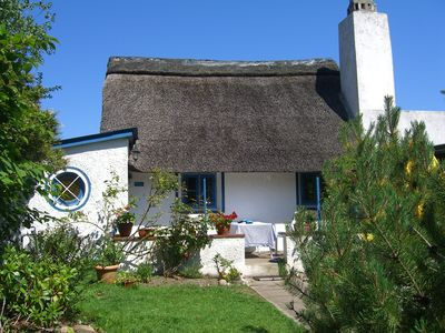 Photo for Quaint, thatched, former fisherman's cottage, 30 m from the beach