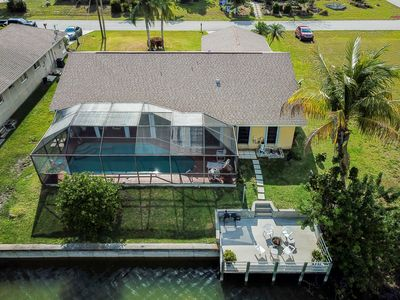 Photo for Large gorgeous 3/3 waterfront house with pool and dock. Boat kayak fishing rod