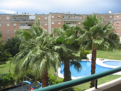 Photo for Apartment overlooking garden and swimming pools