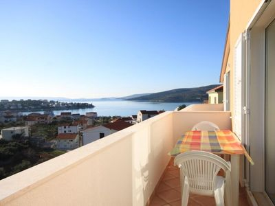 Photo for Two bedroom apartment with balcony and sea view Seget Vranjica, Trogir (A-8507-c)