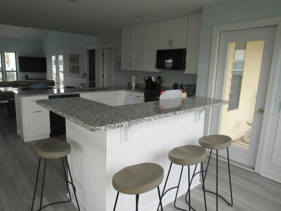 Kitchen Island on street side - door opens to street side screened in porch