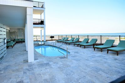 GULF FRONT LOUNGING SPILL OVER & POOL - LARGE TRAVERTINE DECK & SEATING GROUPS