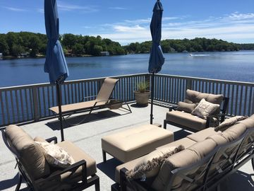 Deck on Boathouse literally extends over the lake.  Comfy new furniture thru-out