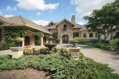 This tuscany designed home is located in Pelican Landing with a touch of modern luxury