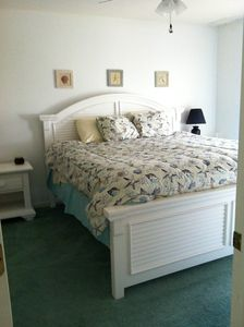 First floor master bed with dresser, walk in closet, full bath