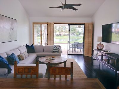 Photo for Modern Getaway! Condo on golf course w/pond view