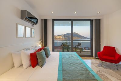 Beautiful master bedroom with ensuite, walk-in wardrobe and balcony with seaview