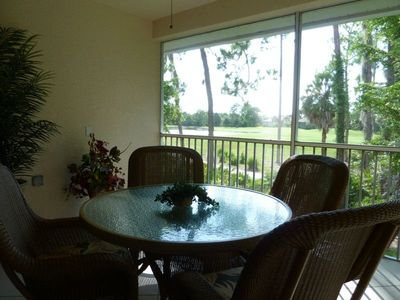 The lanai overlooks a stunning view of the golf course.