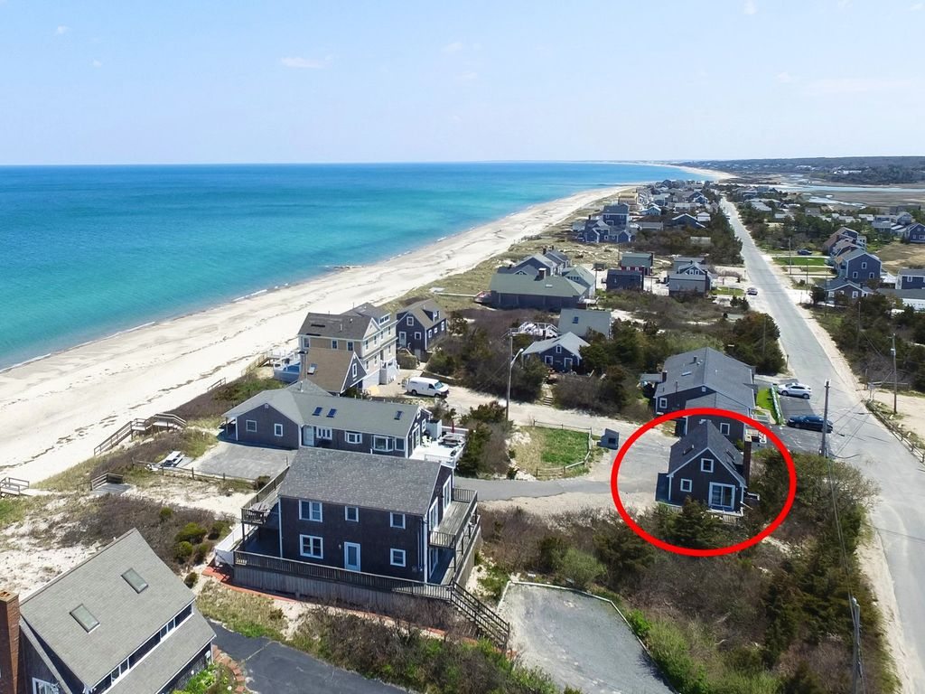 PRIVATE OCEANFRONT Association beach with this updated, contemporary cottage.