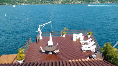 Photo for Delightful house with huge deck over the sea, boat poita and 6 suites