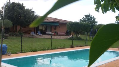 Photo for Can Noguer quiet secluded house with swimming pool ideal families or couples break