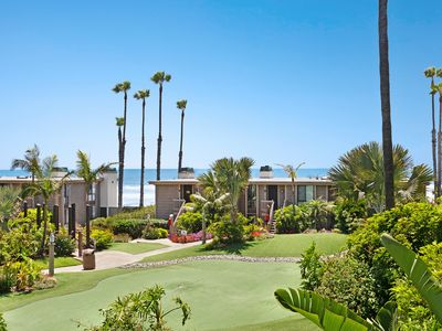 Photo for Ocean view condo w/ balcony & shared pool/hot tub/gym - steps to beach!