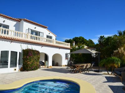 Photo for Spacious, luxurious 10 person villa Moraira, 2 minutes from the beach, pool & terraces