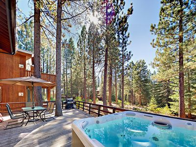 Deck - Your luxe rental includes a private hot tub.