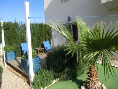 Photo for Bright, modern apartment, with private garden, on the ground floor, 300m from the beach.